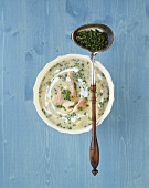 Potato soup with smoked fish and chives