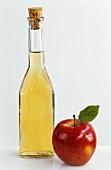 Bottle of cider apple vinegar with fresh apple