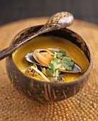 Shellfish soup in a wooden bowl