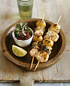 Prawn, shellfish and potato skewers with coriander salad