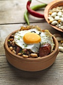 Beans with sausage and fried egg (Greece)