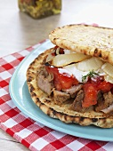 Pork, tzatziki, tomato and onion sandwich (Greece)
