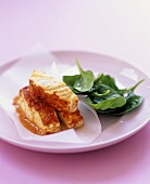 Piri piri haddock with spinach salad