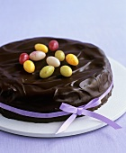 Chocolate sponge cake with sugar eggs for Easter