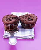 Two chocolate raspberry muffins