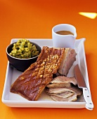 Pork with crackling and mushy peas