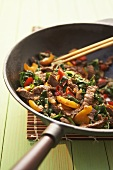 Stir-fried beef with ramsons (wild garlic) and peppers