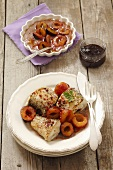 Fried hake with plums