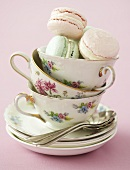 Tea cups with coloured macaroons
