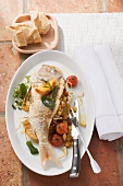 Bream with a tomato and white bread filling