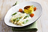 White asparagus with rocket and an egg pastry