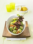Lamb kebab with Brussels sprouts and apricots