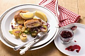 Cordon bleu with cranberries and roast potatoes