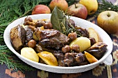 Duck stew with cherries, apples and potatoes