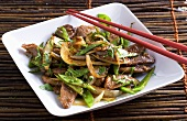 Work-fried duck fillet with mange tout and onions