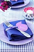 A napkin with a plum shaped place card