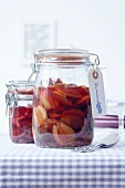 Plum compote in preserving jars with a label