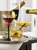 Various cocktails (Negroni, Black Velvet, Mango Mimosa, Calva Spice)