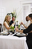 People drinking champagne at elegant table