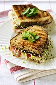 Raw ham, Comte cheese, gherkins & alfalfa sprouts in toast sandwich