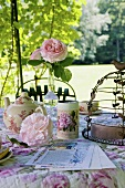 Romantic table in castle garden (La Verrerie, France)