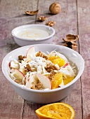 Cabbage salad with apples, oranges and nuts