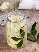 Sauerkraut with apple in preserving jar