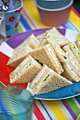Triangular soft cheese sandwiches for a party
