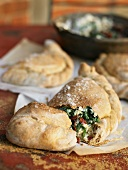 Calzone with spinach and ricotta filling and dried tomatoes