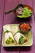 Burritos with bean puree and tomato salsa
