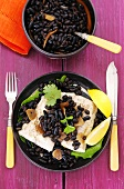 Cod with black beans, garlic and coriander