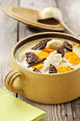 Soup with dried mushrooms, carrots and potato noodles