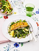 Grilled salmon on rice, green asparagus, spring onions