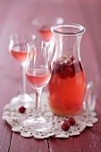 Cranberry liqueur in a carafe and in glasses