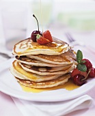 Pancakes with maple syrup, berries and cherries