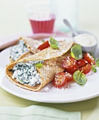 Pancakes with spinach & ricotta filling & cherry tomatoes