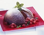 Chocolate ice cream bombe with fresh raspberries