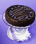 Chocolate truffle cake with candied violets