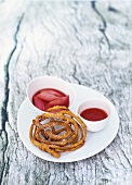 Funnel cake with strawberry puree and rhubarb compote