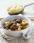 Wild boar ragout with swedes and steamed potato dumplings