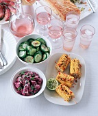 Grilled corn cobs, cucumber salad and beetroot salad