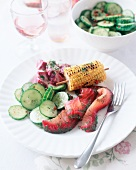 Pickled beetroot salmon with dill, cucumber salad and corn on the cob