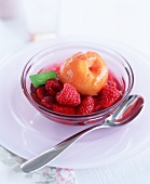 Rosé wine-poached peach with raspberries