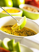 Cheese fondue with Cheddar, spinach and apple