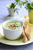Cream of pea soup with bacon strips