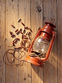 A necklace of wooden beads and an old oil lamp as props for a Western-themed party