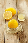 A juicer, lemons and lemon juice