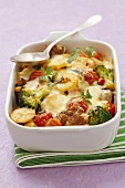 Broccoli and potato bake with tomatoes and meatballs