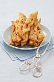 Polish Faworki (deep-fried pastry) with herring