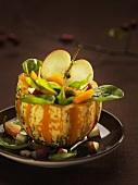 Pumpkin and apple salad in half a pumpkin
